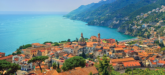 A view of a town on the Mediterranean coastline, which can be toured when you book a Mediterranean cruise with Flight Centre.