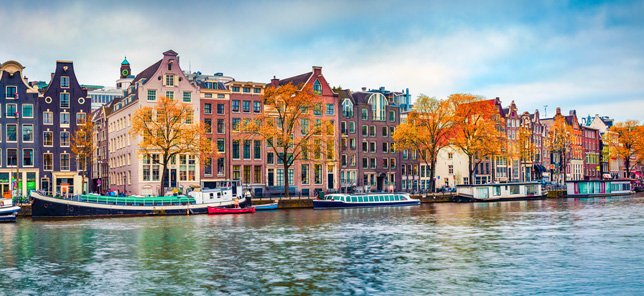 A view of a canal in Amsterdam, which can be visited when you book a hotel or other accommodation with Flight Centre.