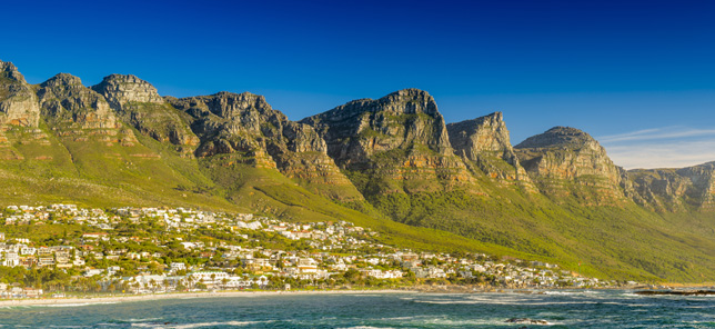 A breathtaking view of the mountains and beaches along Cape Town's coastline that can be explored when you book a hotel or other accommodation with Flight Centre.