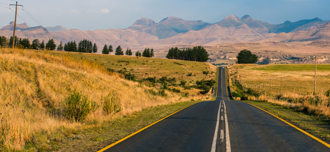 A view of the A view of the picturesque road that leads to Clarens, which can be toured when you book hotel or other accommodation with Flight Centre.