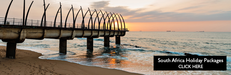 A view of Umhlanga's promenade pier along the South African coastline, which can be visited with a cheap South Africa holiday package from Flight Centre