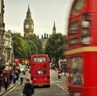 A view of London with Big Ben and red buses, which can be visited with a cheap flight to London with Flight Centre.