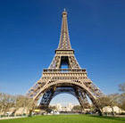 A close-up view of the Eiffel Tower in Paris, which can be visited via a cheap flight from Flight Centre.