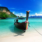 A beach with white sand and clear, blue water can be enjoyed in Thailand, which can be visited via a flight from Flight Centre.