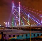 A view of the Nelson Mandela bridge in Johannesburg at night that can be viewed via a cheap flight to Johannesburg with Flight Centre.
