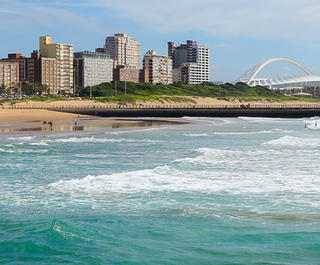 A view of  Durban's Golden Mile coastline, which can be visited with a cheap Durban holiday package from Flight Centre.