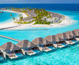 A view of oversea bungalows in the Maldives, which can be experienced with a holiday package from Flight Centre.